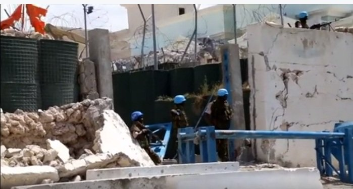 UN guard forces from Uganda looking at at scene of car bombs in Mogadishu.