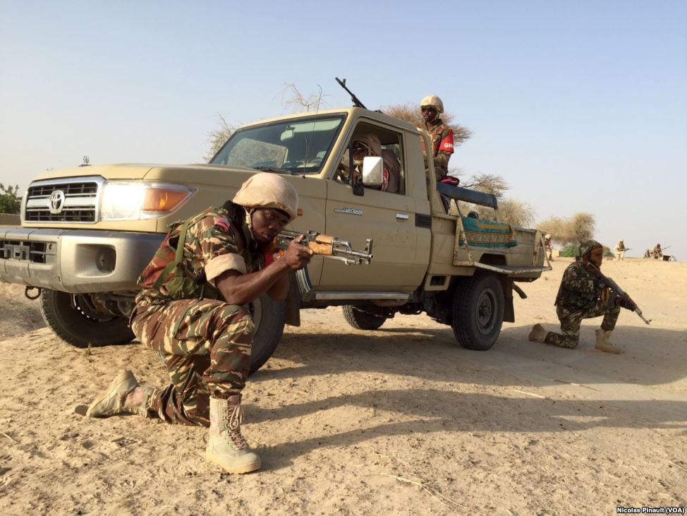 By (VOA/Nicolas Pinault) - http://www.voaafrique.com/media/photogallery/en-images-lutte-armee-nigerienne-contre-invisible-boko-haram/3217712.html, Public Domain, https://commons.wikimedia.org/w/index.php?curid=47347834 Nigerian soldiers attacked