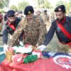 COAS on the funeral of the police officer lost in Mardan attack [Photo by ISPR]