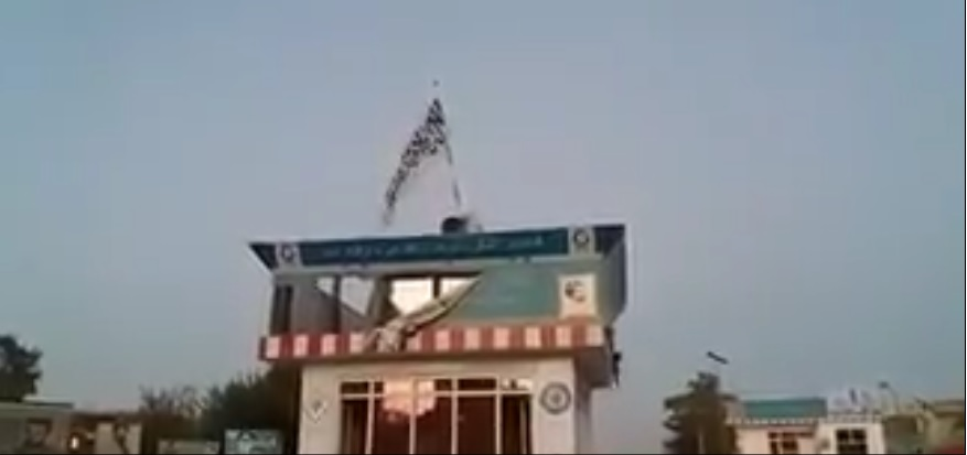 Taliban video showing hoisting of their flag in Kunduzh [photo from video by Taliban spokesman]